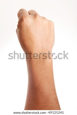 Hand clenched in front of the camera over white background - stock photo