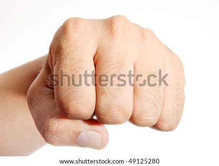 Hand clenched in front of the camera over white background