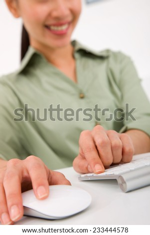 Hand click modern computer mouse and keyboard - stock photo