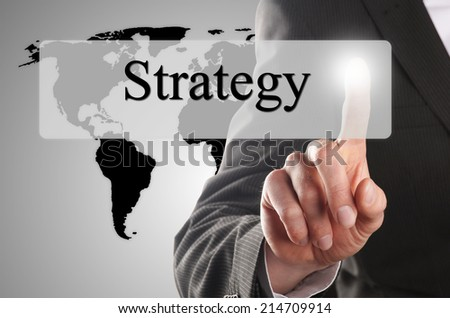 hand click on the button with the word strategy - stock photo