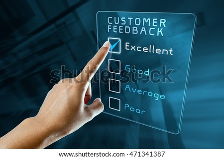 hand clicking online customer  feedback survey on virtual screen interface