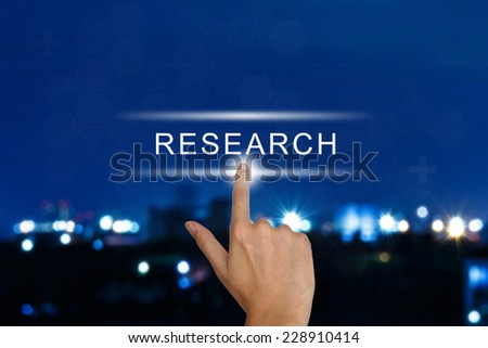 hand clicking research button on a touch screen interface  - stock photo