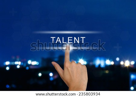 hand clicking talent button on a touch screen interface  - stock photo