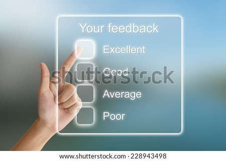 hand clicking your feedback on virtual screen interface  - stock photo