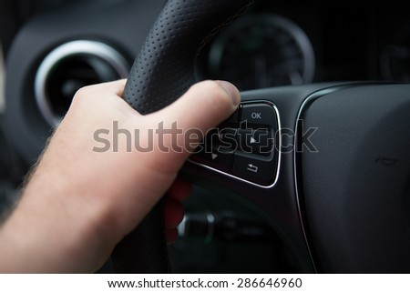 hand close up of a man driving a car - stock photo