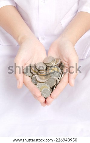 Hand coins to stack of coins on white background background frugality accumulated savings. - stock photo
