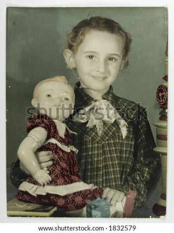 Hand-colored girl's photo with doll - 1950