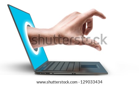 Hand come out from a screen of a laptop computer isolated on white background. High resolution - stock photo