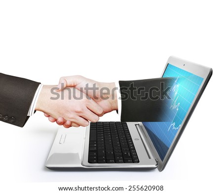 hand comes right out of the laptop screen to shake hands - stock photo