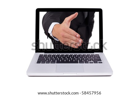 Hand coming out from the screen of the laptop, isolated - stock photo