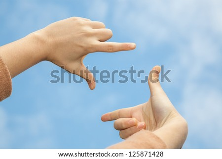 hand composed capture frame up to the sky under blue sky