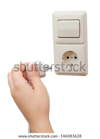 Hand connecting a plug to a socket