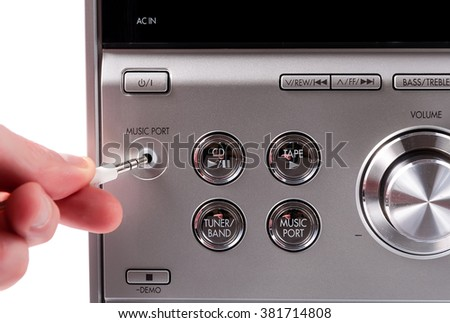 Hand controlling volume of a stereo recorder. Hand controlling volume - stock photo