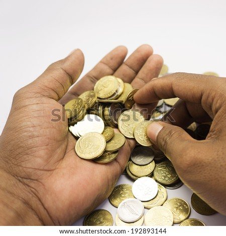 hand counting coins - stock photo