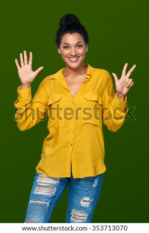 Hand counting - eight fingers. Happy mixed race african american - caucasian woman indicating the number eight with her fingers - stock photo