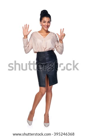 Hand counting - eight fingers. Happy mixed race african american - caucasian woman showing eight fingers standng in full length over white background - stock photo