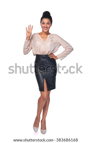 Hand counting - four fingers. Happy mixed race african american - caucasian woman showing four fingers standng in full length over white background - stock photo