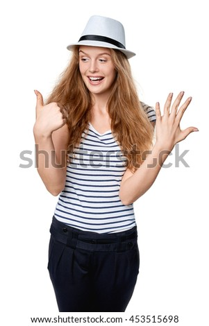 Hand counting - six fingers. Happy excited summer woman in straw fedora hat showing six fingers - stock photo