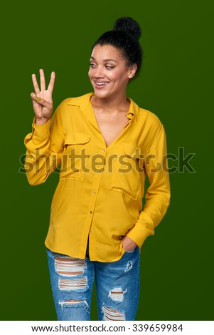 Hand counting - three fingers. Happy mixed race african american - caucasian woman showing three fingers - stock photo