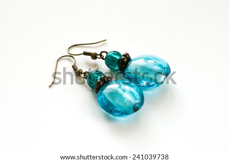 Hand crafted earrings made with blue venetian glass isolated on the white background - stock photo
