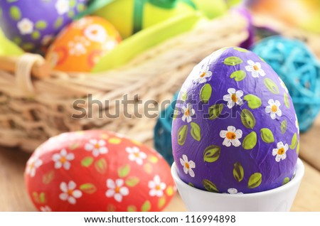 Hand crafted easter eggs with wicker basket - stock photo
