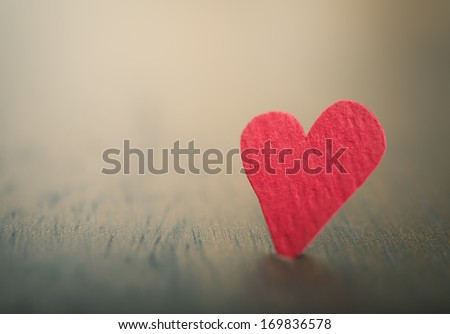 Hand crafted heart in very shallow focus - stock photo