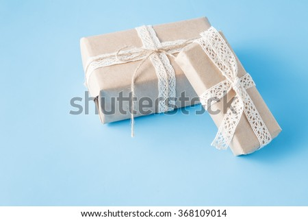 hand crafted present box on blue background - stock photo