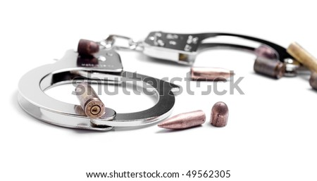 hand cuffs and used bullets - stock photo