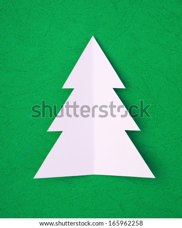 hand cut christams tree on green - stock photo