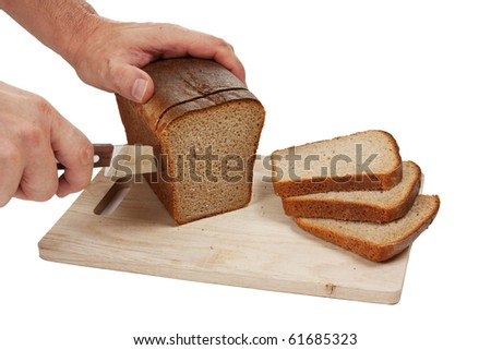 hand cut rye bread on a board isolated on white background