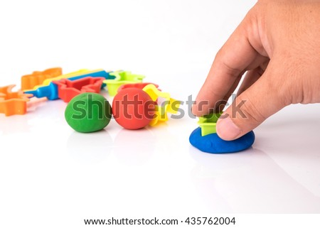 Hand cutting play dough via plastic block