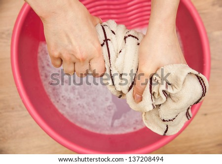 Hand delicate washing of clothes. - stock photo
