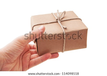 Hand deliver a parcel - stock photo