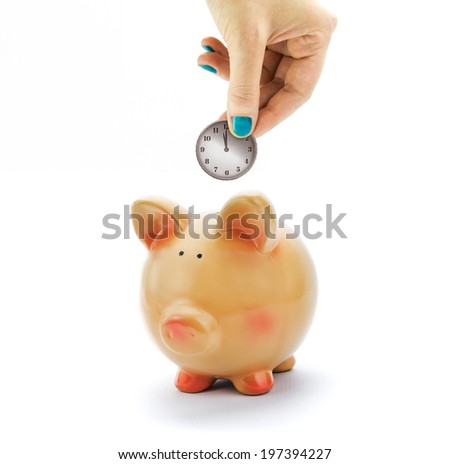 Hand depositing coin with clock dial in piggy bank