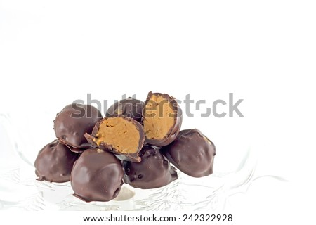 Hand dipped chocolate covered peanut butter creams. - stock photo