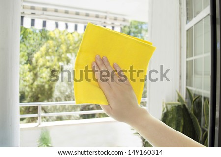 hand dirty glasses cleaning cloth - stock photo