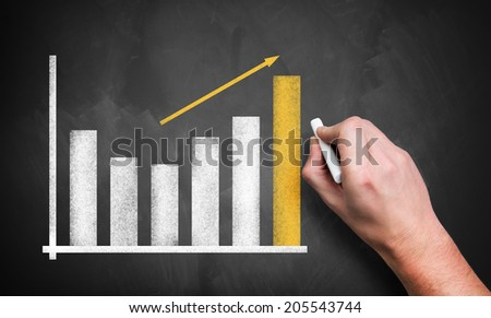 hand drawing a business chart - stock photo