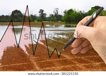 Hand drawing a graph about meteorology - stock photo
