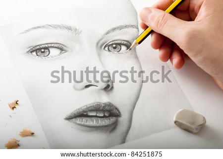 Hand Drawing a Woman Face with Pencil - stock photo