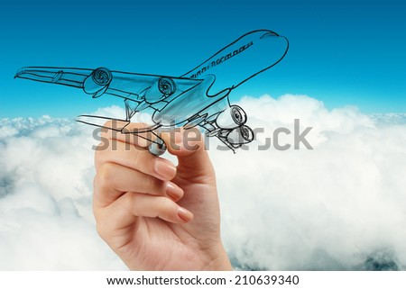 hand drawing airplane on blue sky background - stock photo