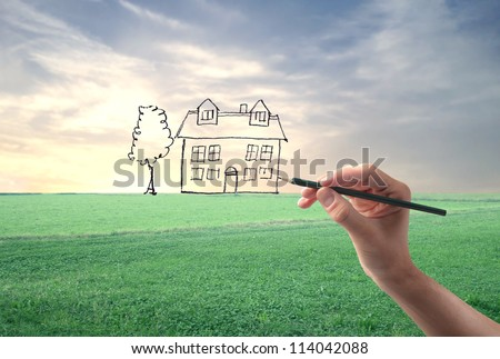 Hand drawing an house on a landscape - stock photo