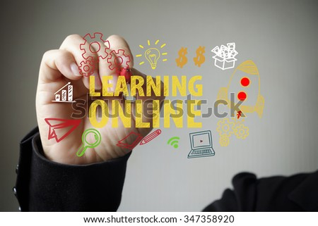 hand drawing and writing LEARNING ONLINE , business concept , business idea - stock photo