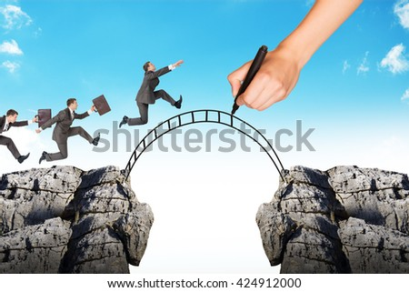 Hand drawing businessman running on bridge and rock on blue sky - stock photo