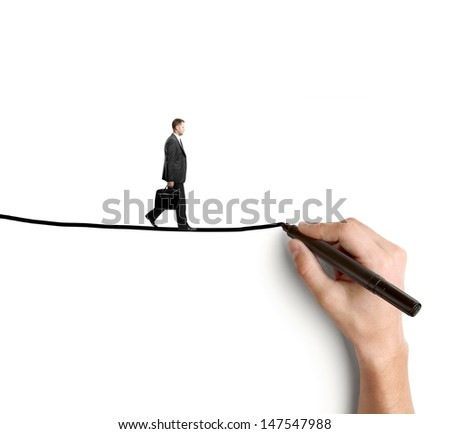 hand drawing businessman walking on rope - stock photo