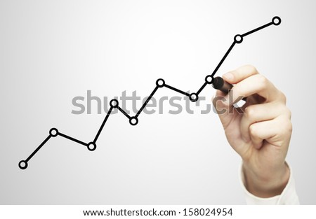 hand drawing chart on a gray background - stock photo