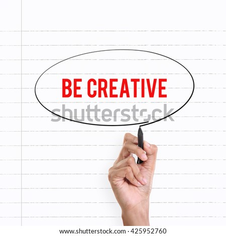 """Hand drawing circle around the note """"BE CREATIVE"""", lined book page on the background - stock photo"""