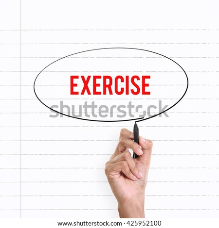 """Hand drawing circle around the note """"EXERCISE"""", lined book page on the background - stock photo"""