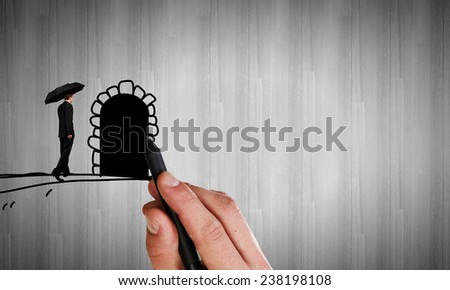 Hand drawing door on wall and businessman entering it - stock photo