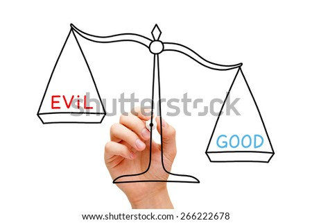 Hand drawing Good or Evil scale concept with marker on transparent wipe board isolated on white. - stock photo