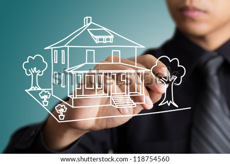 Hand drawing home in a whiteboard - stock photo
